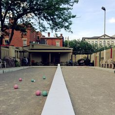 Wind down at a bar with an outdoor patio that has bocce ball or pink pong. perfect weekend.