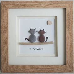 This is a beautiful small Pebble Art framed Picture of 2 Cats - Purrfect  handmade by myself using Pebbles, Driftwood & Wooden Heart This Pebble Picture is framed in a Square Double Mount Frame  Size of Picture incl Frame : approx. 18cm x 18cm  This Picture is finished and only available as shown in Photo  Thanks for looking Doris   Facebook: https://facebook.com/Pebbleartbyjewlls4u     Product Code: P - Violet