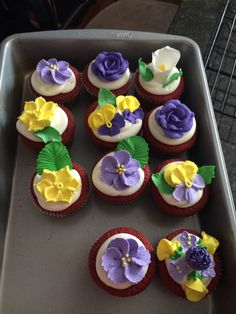 Red velvet cupcakes with gum paste and royal icing flowers.
