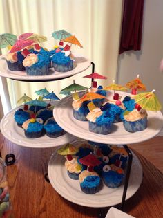 Cupcakes with gummy bears in beach chairs, w/ umbrellas and a beach ball!