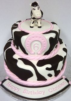 Pinto Horse Birthday Cake - For a little girl who loves Pinto Horses. 8 inch and 12 inch tiers. Gumpaste horse, Fondant Horseshoe.  Sprayed entire cake with a litttle Pearl luster for shimmer.  She LOVED it!!