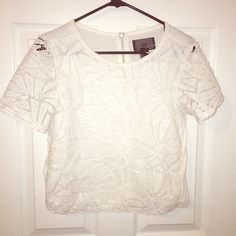 White Sequin H&M Shirt I fell in love with this shirt but I gained weight and it no longer fits! It's in great condition and only wore a few times. H&M Tops Blouses