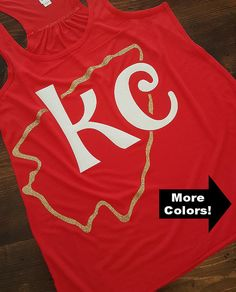 Stunning Kansas City Chiefs flowy racerback tank in your choice of colors! Glitter KC arrowhead design is super sparkly. You will LOVE this soft relaxed tank!  #kcchiefs #kansascitychiefs #chiefstanks #chiefsshirts