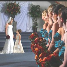 Wedding pictures. Bride, flower girl, and bridesmaids.