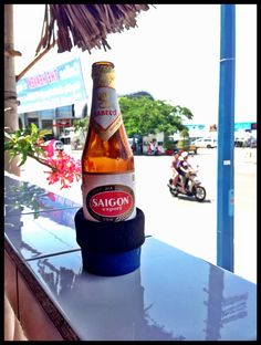 Drinking a Saigon Beer while in Ho Chi Minh - nothing beats an ice cold beer on a hot day!