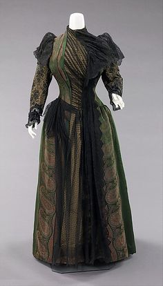 Dress 1889 The bustle silhouette, although primarily associated with the second half of the 19th century, originated in earlier fashions as a simple bump at the back of the dress, such as with late 17th-early 18th century mantuas.