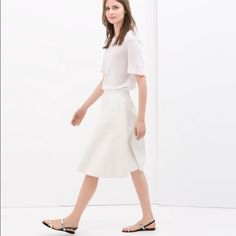 Zara faux leather ruffle white skirt Like new condition. Worn once. But I notice some spots appear from the hanger. They are not so much noticed, but there is several of those. See the example in the picture. Zara Skirts Midi