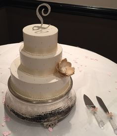 Ivory and gold wedding cake with custom flower and topper www.holiday-market.com