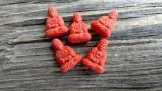 Buddha Pendants, 25x17mm, Pressed Resin, German Made, Opaque Coral, Priced per Piece by DragonflyBeadsStudio on Etsy