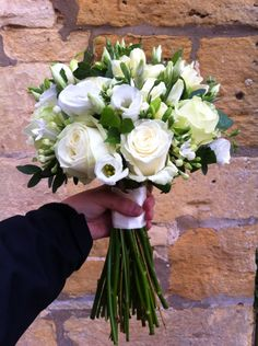 Beautiful classic white and ivory bridal bouquet using avalanche roses, eustoma, ivy
