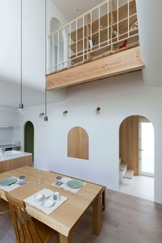 This Japanese home with wood and white interiors, is filled with arched doorways and details.