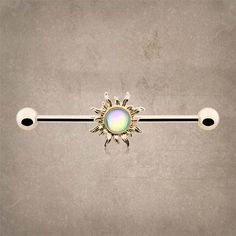 Sun 14kt gold industrial barbell piercing or scaffold piercing for your upper ear. The barbell is 14 gauge and 1-3/8 inches long or 35mm, with both ends unscrewing from the barbell, and the gold sun p