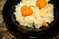 Jamaican Pumpkin rice      2 cups uncooked white rice      ½  lb. Cod fish/salt fish      ½  lb diced pumpkin      2 tsp. Vegetable oil or Olive oil      1 medium onion (chopped)      3 ½  cups water      Salt (to taste)      Black pepper      A sprig of thyme      2 stalk scallions, chopped      2 -3 tbsp butter or margarine      1 Scotch Bonnet Pepper (Optional – used to taste )