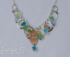 EPBOT: Simply Smashing Penny Jewelry.  Pressed pennies from all the cool amusment parks.