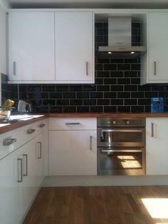 white gloss kitchen black tiles - Google Search
