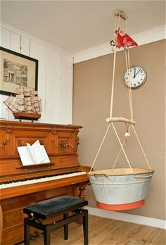 old galvanized tub turned into hanging cradle