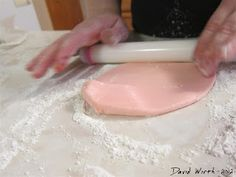 How to Make Fondant for Cake or Cake Pops   http://davewirth.blogspot.com/2012/05/how-to-make-fondant-for-cake-or-cake.html  Pictures and instructions for making fondant for a two layer cake.  The fondant is made from marshmallows and powdered sugar and can be used for decorating or cake pops.    chocolate, decorate, fondant, frosting, how to make cake pops, ingredients, marshmallow, melted chocolate, mix, sticks, sugar