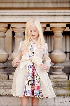 Create the chicest spring soiree outfit by layering a sheer organza coat over a fantastical, floral dress.