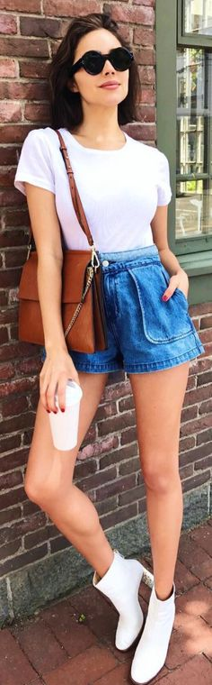 Who made Olivia Culpo's black round sunglasses, blue denim shorts, brown handbag, and ankle boots?