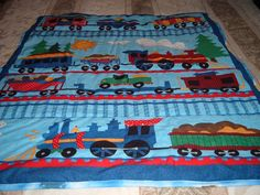 This cute baby quilt has trains on the front and I think I can train fabric on the back.