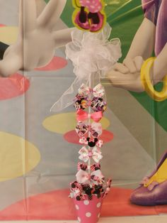 Minnie Bowtique Bow Stand with handmade hair bows.  Make bows ahead of time and people can pick one to wear?