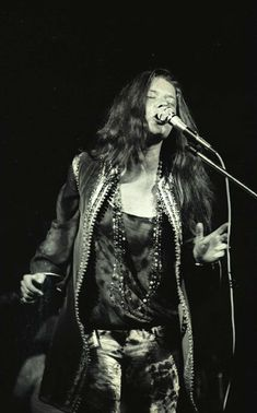 Janis Joplin performing at Woodstock Music Festival