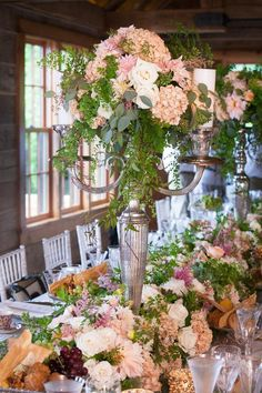 Green and pink pastel flowers by Zinnia Design Florals | Linen Effects - Minneapolis, MN | Table top decor, linen and chair cover rentals