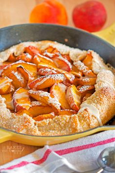 Peach Skillet Galette - Juicy fresh peaches are baked in a delicious, flaky crust for this super easy galette that is baked in your favorite cast iron skillet.