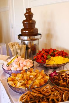 Chocolate Fountain with Yummy Goodies! Strawberries, pretzels, marshmallows, pound cake. Simple no fuss food to dip.