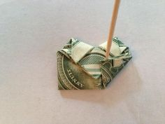 For best results, use a crisp (new) bill which will hold the folds better. Fold diagonally, doesn't matter which side. Fold diagonally again in other direction. Dollar Heart Origami, Easy Dollar Bill Origami, Origami Love Heart, Origami Hearts, Origami Flowers, Origami Star Paper, Origami Ball, Money Origami, Oragami