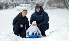 Princess Estelle with her ​​parents in the snow at Haga Palace.