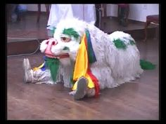 snow lion cute dance in mumbai- presented by tibet/indian group- different use of color  - ear articulation, blinking and jaw