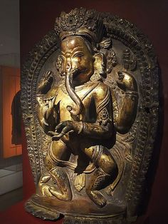 Four-armed Dancing God Ganesha with His Rat Mount Nepal 16th-17th century CE Gilt bronze worked in repousse