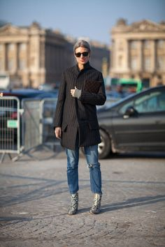 A menswear inspired striped coat is unexpected with torn denim and snakeskin booties.