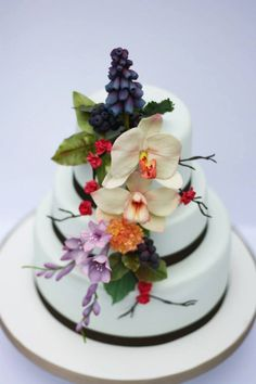 Wild flower and orchid wedding cake. Wedding Cake by Jane Rose Cakes. Baked on Anglesey in North Wales. www.janerosecakes.com