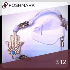 NWT HAMSA BRACELET This bracelet band is a rubber type of material with gold toned beading and gorgeous HAMSA pendant. Jewelry Bracelets