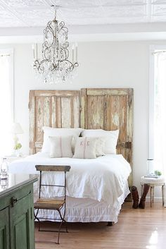 Ga-orgeous bedroom.  Between having old doors make up the headboard, the stunning chandelier, and the overall 'shabby chic' essence of room, it's safe to say I am in love.