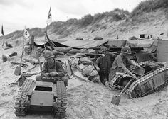 Men of the US Navy attend to two German Goliaths at a first aid station on Utah Beach; Normandy, France - June 1944