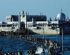 Haji Ali Dargah, Bombay, India is situated in an island on Arabian Sea, which is connected with the main city by a narrow walking path. It is approachable on foot only during the low tides. The path gets submerged in sea water during the high tides.