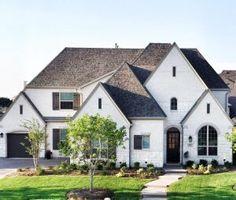 White Stone Exterior white brick, dark wood door and wood shutters. … | pinteres…
