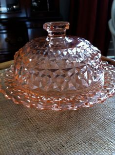 Covered Butter Dish- Holiday / Buttons and Bows was made in the 1940s by Jeannette Glass