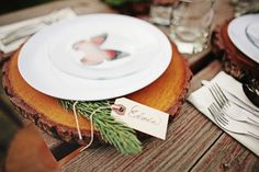 Table settings with wooden trivets & evergreen name tags