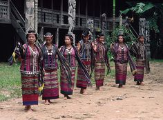 The married Dayak women performing a welcome dance in front of their long house at Mancong. Kalimantan, Indonesia.