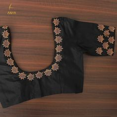 Bright vibrant and attractive the creeper design on this blouse is done exquisitely. Cutwork Blouse Designs, Kids Blouse Designs, Wedding Saree Blouse Designs, Half Saree Designs, Simple Blouse Designs, Stylish Blouse Design, Blouse Neck Designs, Black Blouse Designs, Maggam Work Designs