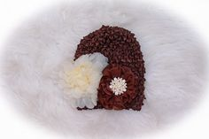 This beautitful brown and cream hat with a gorgeous rhinestone button is one of a kind!