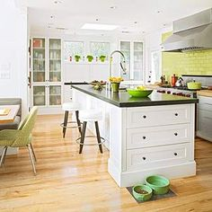Light and Bright, i love the island with drawers on the end and the translucent glass cupboards.