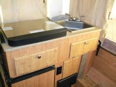 """2011 Used Forest River Rockwood Freedom 2318G Pop Up Camper in California CA.Recreational Vehicle, rv, 2011 Forest River Rockwood Freedom 2318G, Very well maintained washed waxed, stored in garage with tires replaced Aug. 2014, wheel bearings lubed, slides serviced , 12 foot box, XtraRide X-Warranty exp. 2018, Option Package A (Opt. Freedom) Privacy Curtains, Roof Valances, 4"""" Foam Cushions w/ Cover, Under Floor 20 Gallon Fresh Water Tank, A/C Bracing, Patio Light, 110V Exterior Outlet…"""