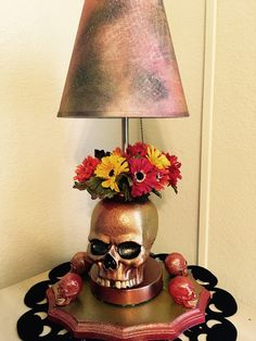 A personal favorite from my Etsy shop https://www.etsy.com/listing/556427219/ooak-diy-goldenorange-skull-lamp