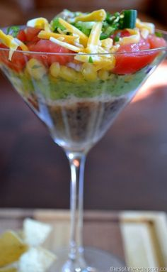 mexican layer dip in individual martini glasses