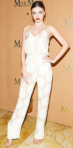 Miranda Kerr celebrated Amy Adams's appointment as the face of the Max Mara accessories campaign in a nude silk Sportmax cami that she tucked into a pair of silk polka dot Sportmax wide-leg pants, styling her separates with vintage Broken English hoops, a delicate Cartier necklace, and nude Alexander Wang sandals.